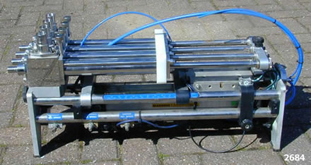 UNIVERSAL POSIFOUR model P4T 4 head inline filler, ATEX rate